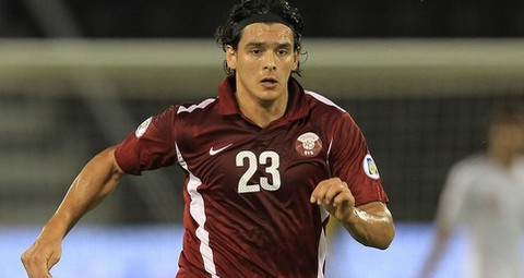 Qatar's Sebastian Soria controls the bal